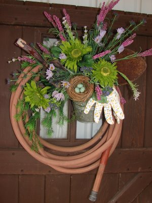 Garden hose wreath for Garden hose idea