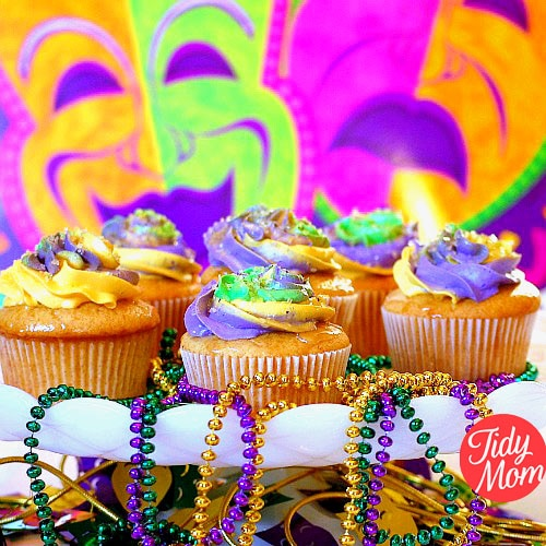 The King Cake might be the traditional sweet on Mardi Gras, but these fun cupcakes are decorated with traditional Mardi Gras colors: purple represents justice, green represents faith and gold represents power. French Vanilla Butter Rum Mardi Gras Cupcakes recipe at TidyMom.net