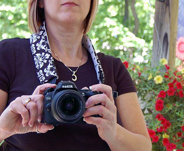 Camera strap cover