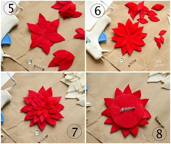 Using the hot glue gun, glue 6 large leaves on to the circle. (be ...