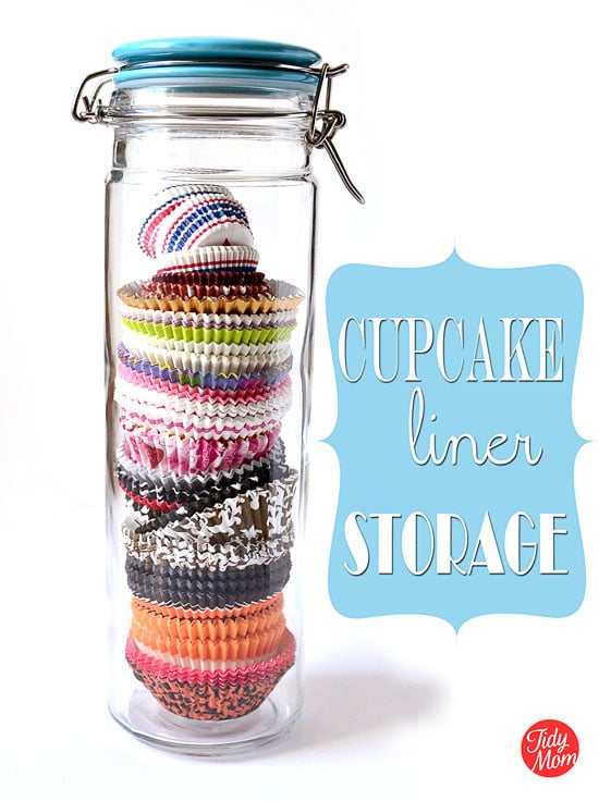 Clever and attractive storage solution. Use tall storage jars to organize and store cupcake liners! They keep their shape, easy to see what you have and look pretty on a shelf or counter!! find more on TidyMom.net