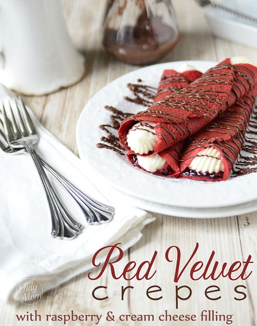 These Red Velvet Crepes will satisfy a multitude of cravings with raspberry preserves and a kicked up sweet cream cheese filling to the Nutella drizzled over top! A perfect treat for Valentines Day or any day! Print the full recipe at TidyMom.net