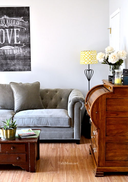 tufted back gray sofa at Tidymom