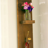 DIY Reclaimed Wood Sconce with Hook tutorial from Pretty Handy Girl at TidyMom.net