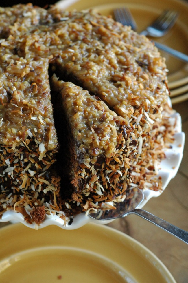 German Chocolate Cake infused with rum and toasted coconut!  recipe at TidyMom.net