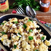 The BEST Roasted Cauliflower recipe with Italian dressing, feta cheese and browned butter crouton crumbs at TidyMom.net