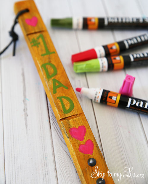 use paint markers to make a DIY Personalized Grill Spatula.  Tutorial at Tidymom.net