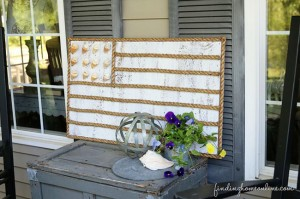 Bring a little bit of the beach right to your front porch. DIY Rope and Shell Beach Flag from FindingHomeOnline.com tutorial at TidyMom.net