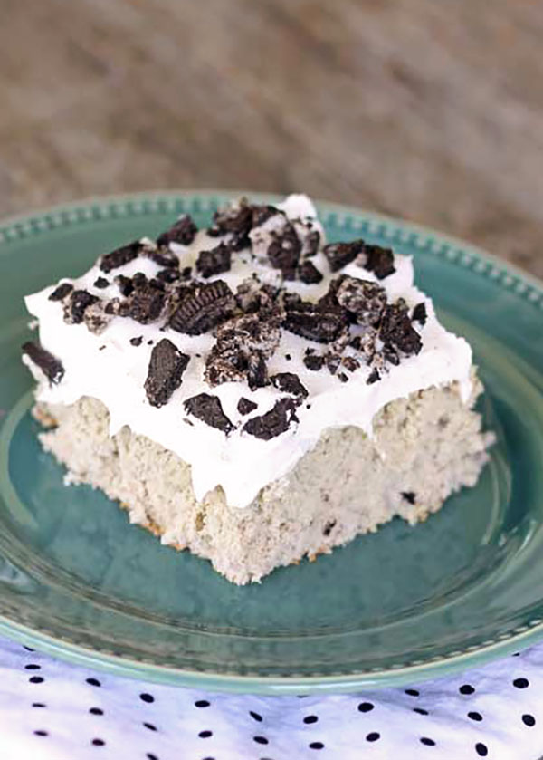 The perfect dessert for potlucks- Cookies and Cream Poke Cake recipe at TidyMom.net