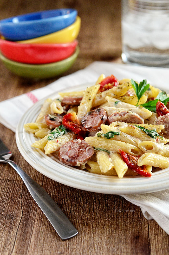 Kicked Up Turkey Sausage Alfredo with spinach and sundried tomatoes. Recipe at TidyMom.net