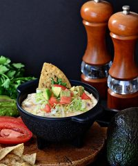 White Chili Bean Queso Dip with zesty tomatoes, cheese and Bush's white chili beans served warm with tortilla chips is sure to be a hit at any party. recipe at Tidymom.net