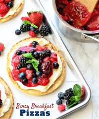 Mixed Berry Breakfast pizza tastes as good as it looks! It's impossible to resist the toasted pita crust, rich orange cream cheese layer and glossy berry topping. It's so convenient to prepare the night before and serve the next morning, or any time of day! Full recipe at TidyMom.net