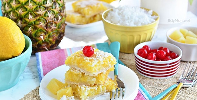 Channel the tropics, lounging on a white sandy beach, with these Pina Colada Bars. Enjoy the flavors of coconut and pinaple and consider it your ticket to a mental tropical paradise. grab the recipe at TidyMom.net