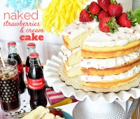 Naked Strawberries and Cream Cake. 3 delicious layers of homemade pound cake, with fresh strawberries and a dreamy vanilla whipped cream cream cheese frosting.