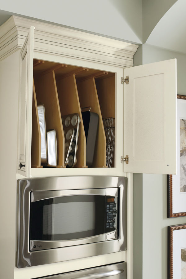 Storing party trays, serve ware and even seldom used bakeware is ideal above the oven, using our Oven Cabinet with Tray Dividers built right in to the top of the cabinet.