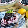 Blueberry Yogurt Pie is the perfect dessert for summer! This pie starts off with a simple shortbread crust filled filled with yogurt and blueberries then topped off with lemon blueberry fruit spread.