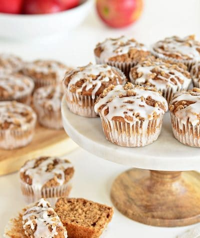 These Apple Spice muffins with Struesel Topping have a suprise ingredient that packs them with fiber!! Applesauce, spices, baked beans, crumb topping, vanilla glaze combine to create a delicious breakfast treat or afternoon snack. Bake a batch and enjoy the warm fall flavors! muffin recipe at TidyMom.net
