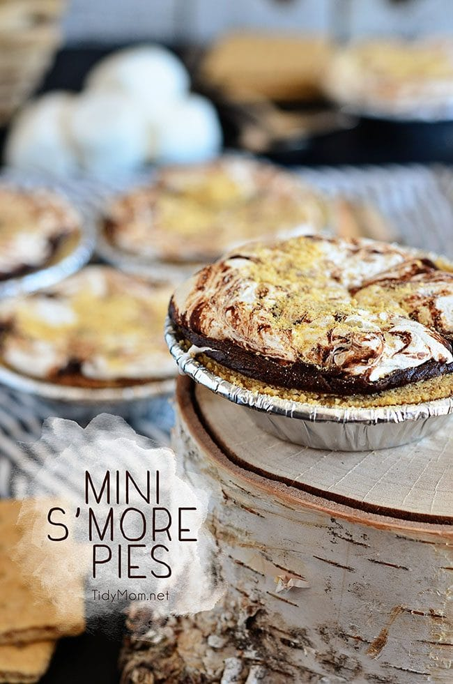 Mini S'more Pies are the perfect dessert for entertaining. Not only do they require very little work, but they can be made ahead of time. Serve warm, room temperature or chilled. Either way, it's a chocolate, marshmallow, graham cracker deliciousness presented in the form of a decadent mini pie. Mini S'more Pies recipe at TidyMom.net
