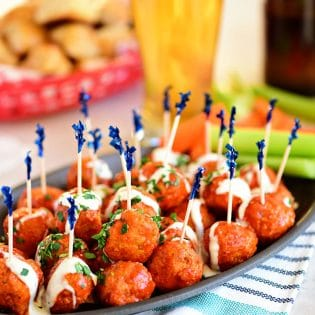 Game Day Part Plan Buffalo Chicken Meatballs with Ranch tastes just like buffalo hot wings. Get the recipe at TidyMom.net