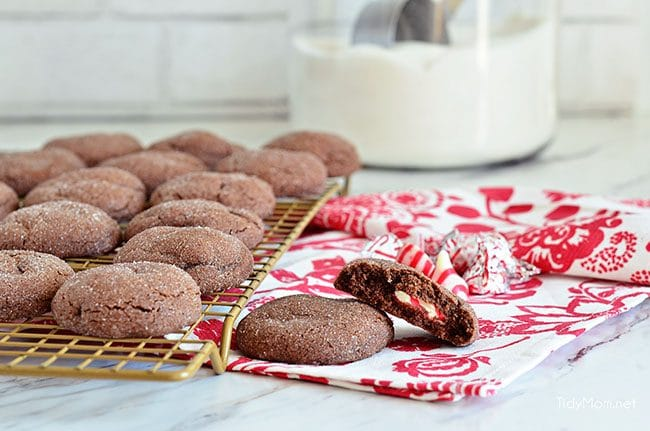 Super soft chocolatecookies hold apeppermint kiss in the center in these PeppermintSurprise CrinkleCookies. So delicious