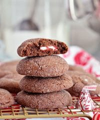 Super soft chocolate cookies hold a peppermint kiss in the center in these Peppermint Surprise Crinkle Cookies. Find the recipe at TidyMom.net