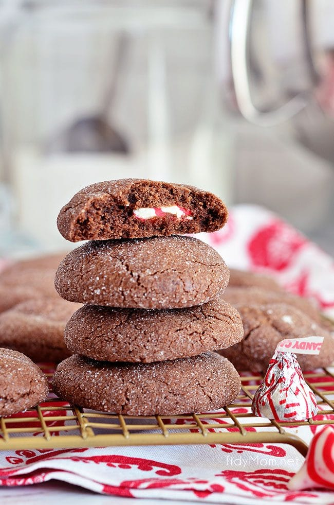 Super soft chocolatecookies hold apeppermint kiss in the center in these PeppermintSurprise CrinkleCookies. Find the recipe at TidyMom.net