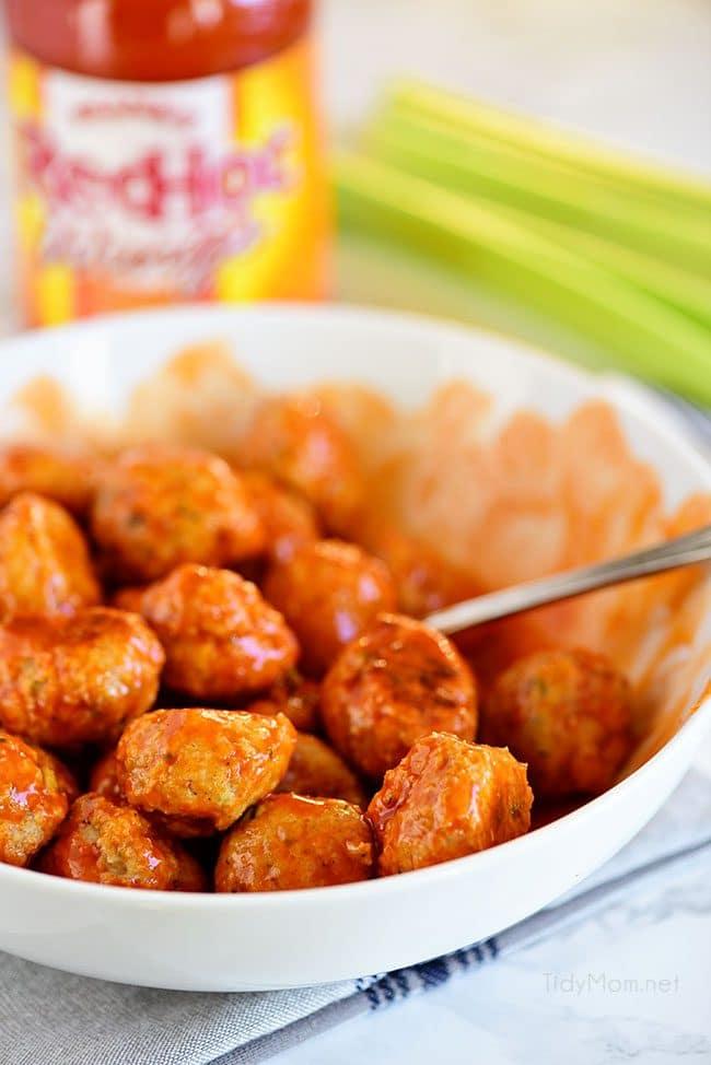 Crowd pleasing Buffalo Chicken Meatballs with Ranch taste just like buffalo hot wings. Get the recipe at TidyMom.net