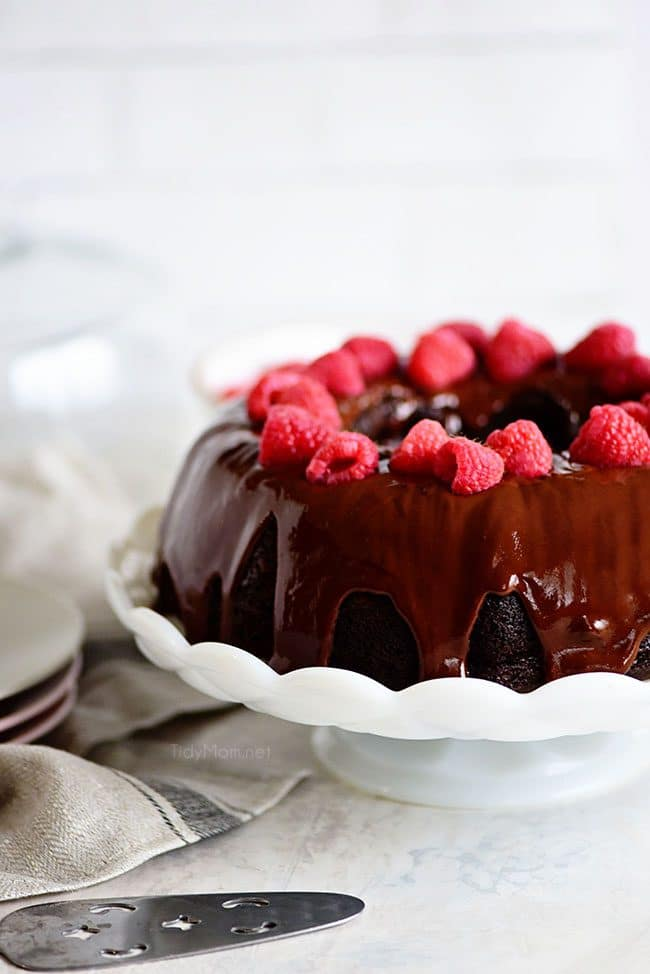 Easy and delicious Chocolate Raspberry Bundt Cake starts with a dark chocolate cake mix, raspberry pie filling and a splash of Chambord for a delicious dessert. Get the full printable recipe for this bundt cake at TidyMom.net