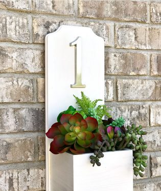 Increase your curb appeal with an address planter box. This DIY house number is super simple and quick to make and doesn't require any tools. Get the full tutorial at TidyMom.net