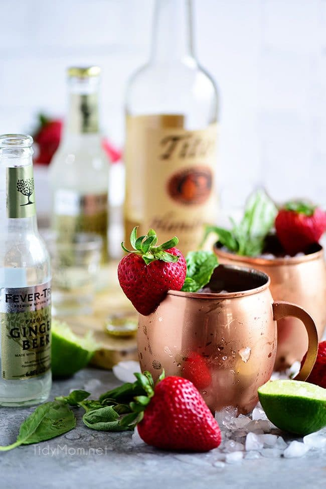 Strawberry Basil Moscow Mule is the perfect summer cocktail. Made like a traditional Moscow Mule with vodka, ginger beer and lime, with the addition of muddled fresh juicy strawberries and basil. Print the recipe at TidyMom.net Delicious!