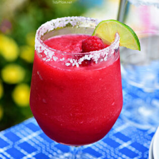 Frozen Raspberry Margarita is the perfect summer cocktail. Raspberry sorbet puts a refreshing twist on the traditional margarita, for a cool party sip! Get the full recipe at TidyMom.net - always a hit!