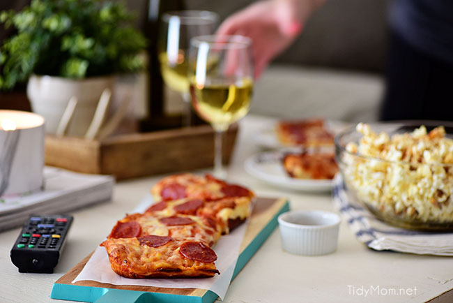 Pizza and Popcorn Movie Night. Make Gourmet Popcorn at home for a special treat. Oven-ready pizza, Sweet Heat Maple-Chili Popcorn, something to sip on and your favorite movie and you have a perfect date night at home. Print the gourmet popcorn recipe at TidyMom.net