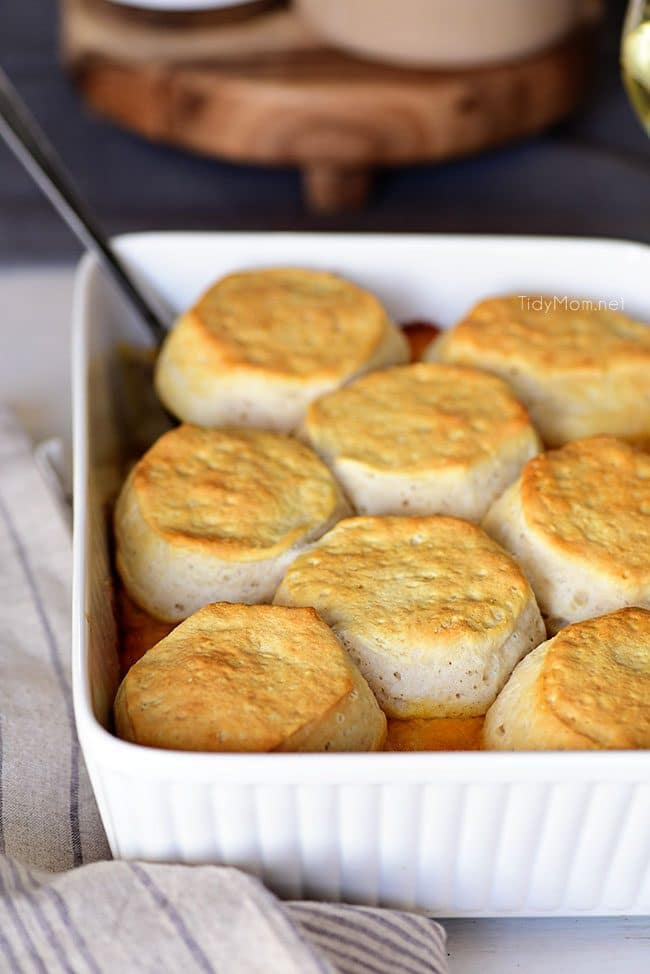 Chicken and Cheese Biscuit Bake in white baking dish on table