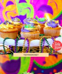 mardi gras cupcakes on a white platter