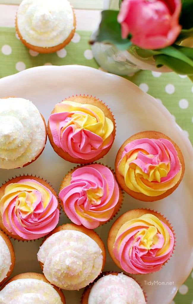 raspberry filled cupcakes with pink and yellow vanilla buttrcream