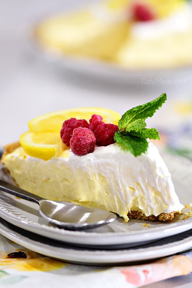 A slice of lemonade pie on a plate with a spoon