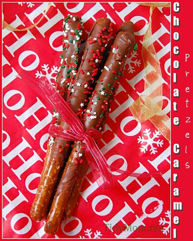 Caramel Dipped Pretzel Rods tied with a ribbon