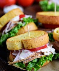 Turkey Caesar Sandwich. Easy homemade caesar dressing and garlic toast turns an ordinary cold-cut sandwich into something special. Perfect way to use up left-over Thanksgiving turkey or any day with deli sliced turkey! Print recipe at TidyMom.net