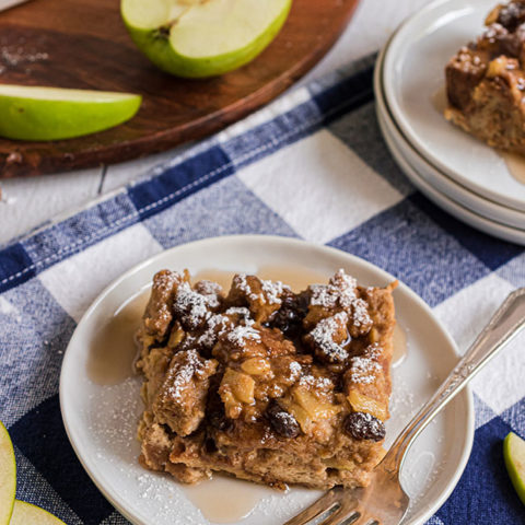 bread pudding on a plate with a fork