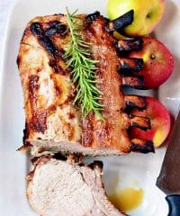 juicy brined rack of pork on white platter