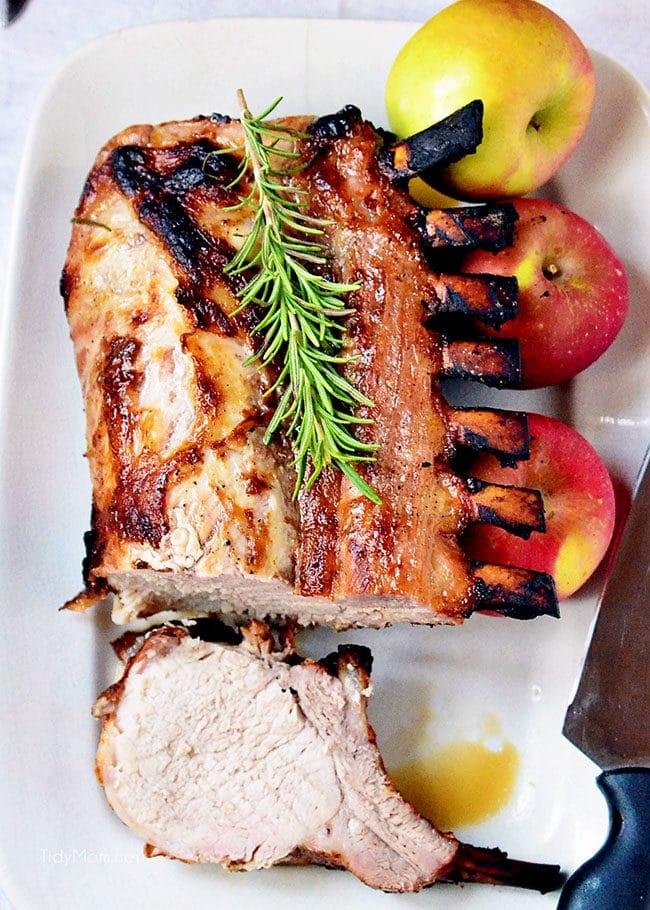 juicy brined rack of pork on white platter