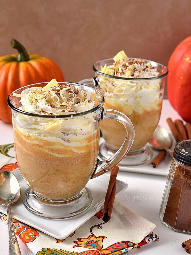 Pumpkin Spice White Hot Chocolate in a mug with whipped cream