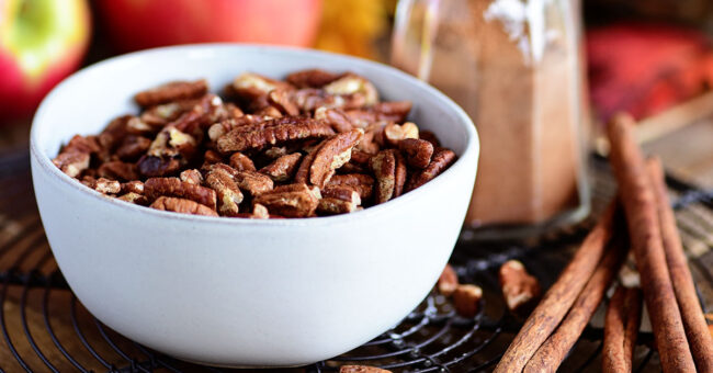 toasted pecans in white bowl
