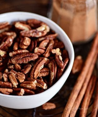 close up of toasted pecans with cinnamon