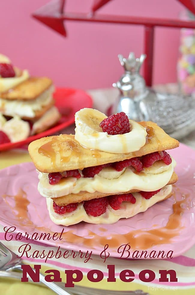 Napoleon dessert recipe with raspberries and bananas on heart shaped plate