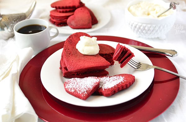 Red Velvet pancakes can make an ordinary breakfast feel extraordinary. Especially when you make them heart shaped for Valentines Day. Get the recipe at TidyMom.net