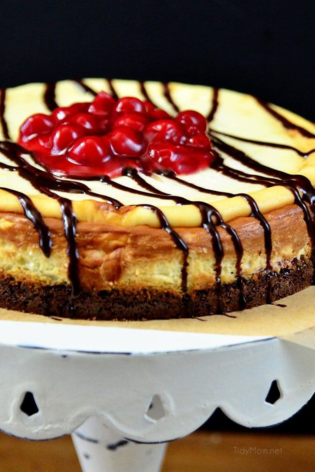 Brownie Cherry Cheesecake on cake stand