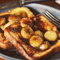 Decadent french toast with home made caramel sauce and bananas, an easy to make gourmet breakfast you can make at home. Caramelized Banana French Toast recipe at TidyMom.net