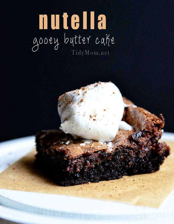 slice of NUTELLA GOOEY BUTTER CAKE with whip cream on top