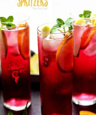 Delicious Apple Pomegranate Spritzers are fizzy, fruity and full of antioxidants (hello pomegranate!) and non-alcoholic. You could swap out the lemon-lime soda for white wine if you'd prefer a boozy version. Perfect for any occasion! Print simple and refreshing cocktail recipe at TidyMom.net